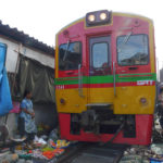 Bangkok's Famous Maeklong Railway Market Sits on Functioning Train Tracks